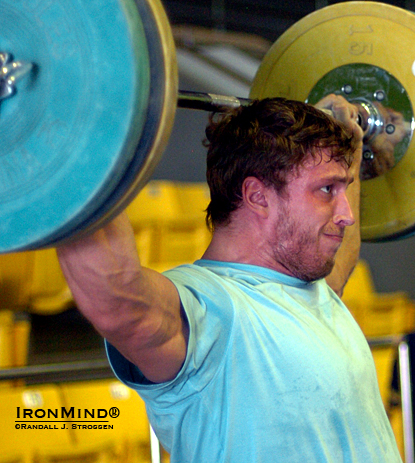 Dmitry Klokov, likely to be lifting for Russia in the 105-kg category at the London Olympics, knocks off some squat snatch-push presses behind the neck combinations in the training hall at the 2007 World Weightlifting Championships.  IronMind® | Randall J. Strossen photo.