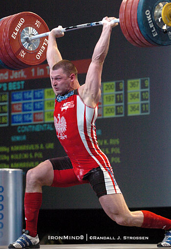 "Szymon Kolecki (Poland) has locked out this 218-kg jerk at the 2007 European Weightlifting Championships and is supporting the weight in a way that provides tremendous training benefits - Jim Schmitz (""Schmitz on the Lifts"") explains how and why to train on this phase of the jerk. IronMind® 
