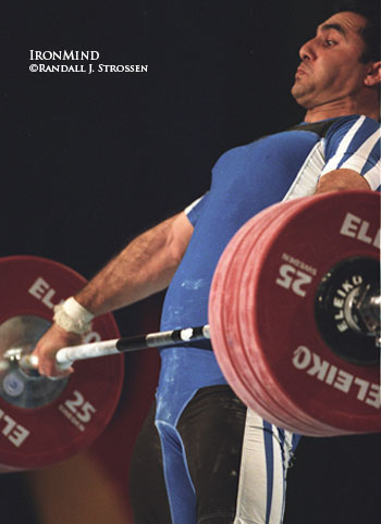 Lifting in the 94-kg category, Kouroush Bagheri (Iran) cranks on this 180-kg snatch at the 2003 World Weightlifting Championships (Vancouver). IronMind® | Randall J. Strossen, Ph.D. photo.