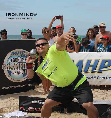 Krzysztof Radzikowski on the 14-kg shot put at SCL Portugal.  IronMind® | Photo courtesy of SCL