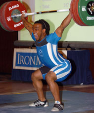 Lance Frye on his way up with his 150-kg snatch, which gave him a solid lead in the men's 77-kg category. IronMind® | Randall J. Strossen, Ph.D. photo.