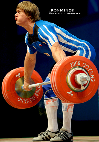 lapikov-191_lg Dmitri Lapikov (Russia) smoked this 191-kg snatch in the 105s at the 2009 World Weightlifting Championships.  Using straps wisely in training helps increase your top lifts in competition.  IronMind® | Randall J. Strossen photo.