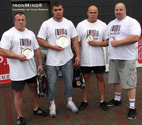 Left to right: Lauris Gabrans (second place), Roberts Kieperszo (first place), Oskars Laksa (third place) and and Guntars Kusinsh (president of LSAF, Latvian Federation for Amateur Strongman).  IronMind® | Photo courtesy of Vlad Redkin.