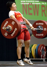 Li Ping (China) finishing the pull on her 126-kg clean and jerk at the World Weightifting Championships today. IronMind® | Randall J. Strossen, Ph.D. photo.