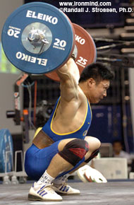 Li Hongli hits the bottom, and pay dirt, with this 165-kg snatch. IronMind® | Randall J. Strossen, Ph.D. photo.
