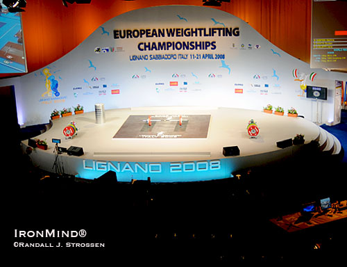 "The 2008 European Weightlifting Championships (Lignano Sabbiadoro, Italy) were a sight to behold: nary a straight line to be found on stage, where curves danced instead, the stage was bright while the surrounding area was dark.  Drama had come to weightlifting and in the September 2008 issue of MILO, Randall Strossen wrote, ""What the EWF accomplished can hardly be overstated,"" in an article entitled ""Best Staging, Best Lighting . . . The New Look of Weightlifting.""  IronMind® 