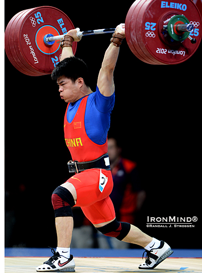 Olympic weightlifter Lin Qingfeng won the gold medal in the men's 69-kg category with this opening clean and jerk of 182 kg.  If it looked easy, maybe that's why he went on to take 198 kg on his third attempt.  IronMind® | Randall J. Strossen photo.