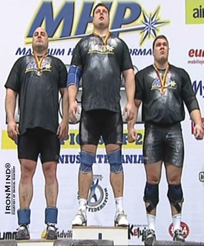 Flanked by his teammates Vidas Bleikaitis (left) and Vytautas Lalas (right), Zydrunas Savickas (center) was king of the hill at the 2011 Log Lift World Championships.  IronMind® | Courtesy of Marcel Mostert.