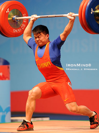 Long Qingquan missed the jerk on this 169-kg attempt - had he made it, the lift would have been good for one senior and two junior world records.  IronMind® | Randall J. Strossen photo.
