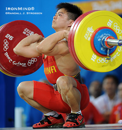 It was the only lift he missed all night: After cleaning this 164 kg on his third attempt, Long Qingquan punched the jerk up and over the back of his head, but no matter, the 17-year-old won the 56-kg category at the Olympics today. IronMind® | Randall J. Strossen, Ph.D. photo.