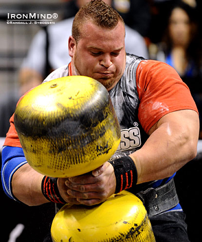 Louis-Philippe Jean works on the Circus Dumbbell, part of the overhead medley at the 2010 World Strongman Super Series–Mohegan Sun.  IronMind® | Randall J. Strossen photo.