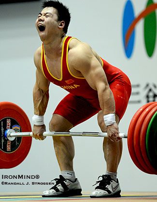 Lu Chang Liang (China) starts 195 kg on its way to the gold medal lift in the total. IronMind® | Randall J. Strossen photo.