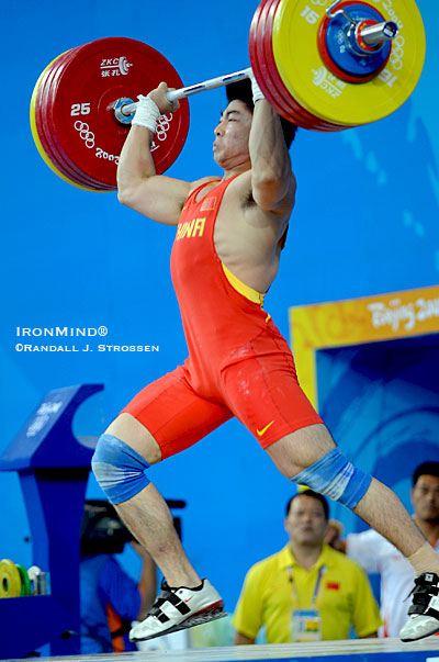 Lu Yong drives under this third attempt 214-kg jerk. He'd already done the lift once and had it passed with three white lights, only to have the jury reverse it. IronMind® | Randall J. Strossen, Ph.D. photo.
