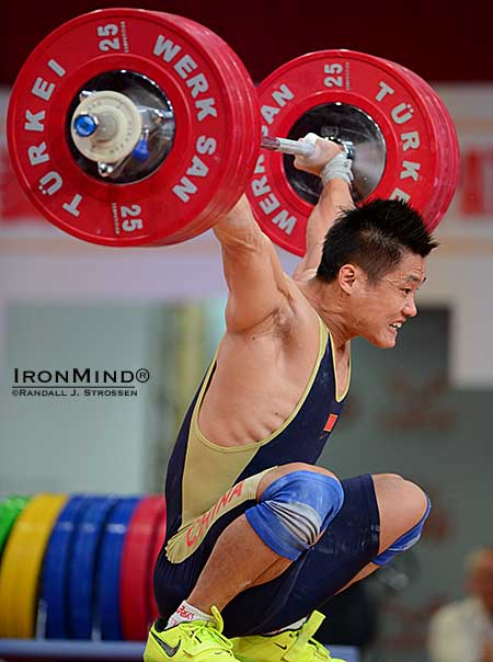 77-kg weightlifter Lyu Xiaojun hits the bottom with a 176-kg world record snatch locked out overhead.  IronMind® | Randall J. Strossen photo