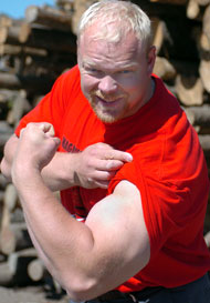 World's Strongest Man winner Magnus Samuelsson shows what we're talking about when he flexes his arm at the 2004 World Muscle Power Championships (Dolbeau-Mistassini, Quebec). IronMind® | Randall J. Strossen, Ph.D. photo.