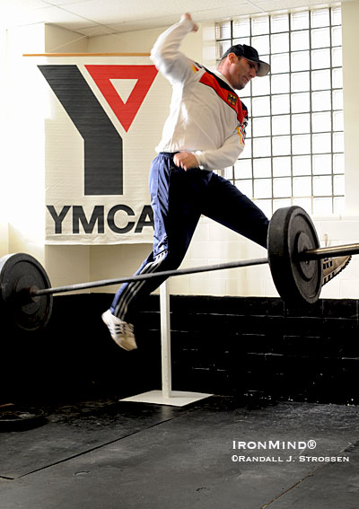 Proving that he can still lift - and jump - Marc Huster joined his teammates at the Downtown Columbus YMCA yesterday. IronMind® | Randall J. Strossen photo