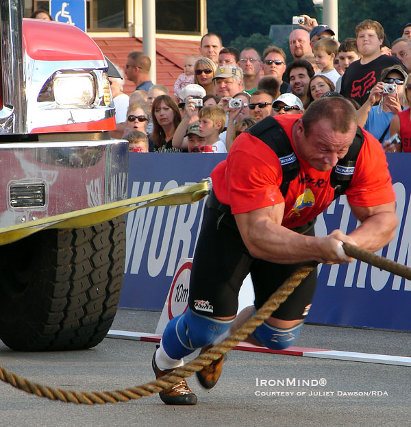 It's the archetypal strongman contest, event and competitor: Mariusz Pudzianowski, five-time winner of the World's Strongest Man contest, pits his muscles against a semi in the truck pull.  IronMind® | Photo courtesy of RDA.