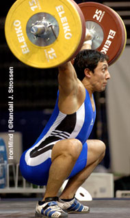 2000 Olympic silver medalist Georgi Markov (Bulgaria) sticks his 155-kg opening snatch at the 2005 World Weightlifting Championships (Doha, Qatar). IronMind® | Randall J. Strossen, Ph.D. photo.