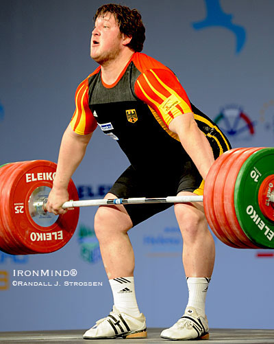 This is the approximate starting position when you lift off blocks - it might look innocent, but remember that this merely sets the stage for the acceleration and explosion that will follow. Shown here is Matthias Steiner, launching 200 kg at the 2008 European Weightlifting Championships. IronMind® | Randall J. Strossen photo.