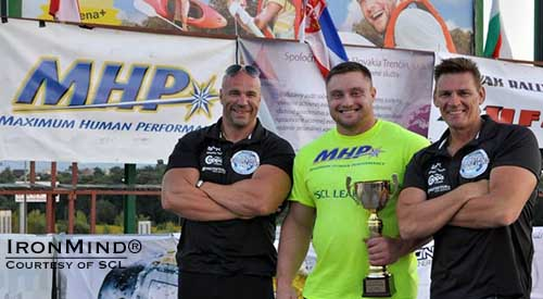 2013 MHP Strongman Champions League world champion Krzysztof Radzikowski (center), flanked by SCL directors Ilkka Kinnunen (left) and Marcel Mostert (right).  IronMind® | Image courtesy of SCL