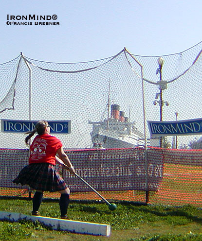 Michele Green winds up on the hammer, with the Queen Mary keeping an approving eye on the action.  IronMind® | Francis Brebner photo.