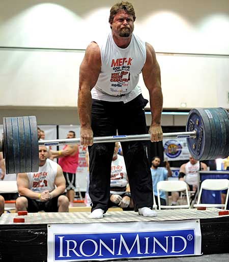 Mike Burke leads everyone on the Apollon's Axle double overhand deadlift—a staple test in the grip strength world.  If you are chasing this lift yourself, you might like to hear that Mike struggled to pull this 516-lb. world record lift at the grip strength contest held at the 2013 Los Angeles FitExpo, but he didn't.  In fact, he followed this success by pulling 528 lb. to his knees, so eat your Wheaties if you're chasing Mike.  IronMind® | Randall J. Strossen photo.