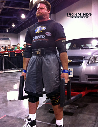 Mike Burke on the Car Deadlift for reps at the Olympia Strongest Man contest.  IronMind® | Courtesy of ASC.