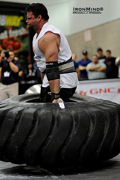 One of the unusual events Odd Haugen included this contest was a tire deadlift with nothing to grab but the tire itself.  Mike Burke blew through this like nothing on his way to the overall win at the LA FitExpo today.  IronMind® | Randall J. Strossen photo.