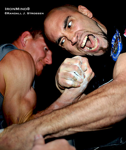 """You're dinner!"" Mike Selearis (right) might have roared as he tore into Bryan Johnson (left) at the USAA National Pro Am Armwrestling Championships at the Tahoe Biltmore in Crystal Bay, Nevada last night. ""They will be scared to arm wrestle you after this,"" Randall Strossen said to Mike Selearis when he showed Selearis this image right after the shot was taken. Selearis went on to win the pro left 177 - 198-pound class and place second in the pro right 177 - 198-pound class. IronMind® 
