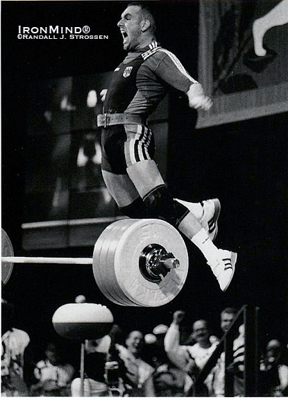 "Marc Huster celebrates his world record 213.5-kg clean and jerk in the 83-kg class at the 1996 Olympics.  When Randall Strossen once asked Marc Huster if he'd ever considered a career as a high jumper, the ebullient weightlifter said, ""Maybe a kangaroo.""  IronMind® 