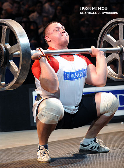 Putting his Olympic-style weightlifting background to good use in a strongman contest, Mikhail Koklyaev squat cleans the IronMind® Apollon's Axle™ at the recent Giants Live competition held at the Mohegan Sun.  IronMind® | Randall J. Strossen photo.