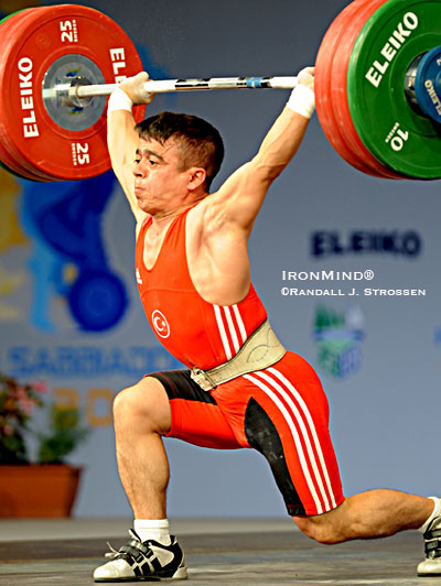Halil Mutlu (Turkey) didn't have the easiest time making this 149-kg jerk at the 2008 European Weightlifting Championships, where he placed second to Igor Bour (Moldavia), but Bour was just disqualified and now Mutlu - a three-time Olympic gold medalist who will be looking for his fourth gold medal in Beijing - is the 2008 European Weightlifting champion in the 56-kg category. IronMind® | Randall J. Strossen photo.