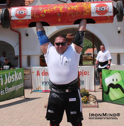 Ákos Nagy, second place in the 2012 Hungary's Strongest Man contest, on the log lift.  IronMind® | Photo courtesy of Adam Darazs.