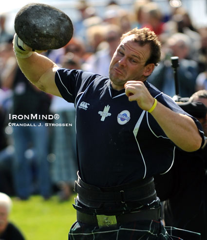 Aaron Neighbour, 2009 IHGF Highland Games World Champion, on the Braemar Stone (Edinburgh, Scotland).  IronMind® | Randall J. Strossen photo.