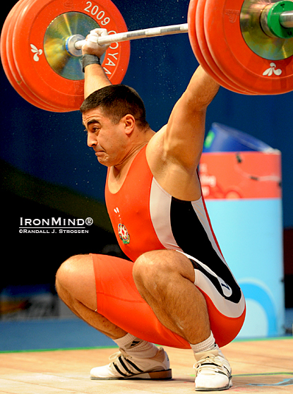 "94-kg Nizami Pashaev (Azerbaijan) always good for some for some colorful moments and big lifts, nailed this 177-kg snatch at the 2009 World Weightlifting Championships, illustrating what would be the bottom position for an overhead squat.  Jim Schmitz says, ""Because the overhead squat is such a great exercise for developing balance, flexibility, coordination, and strength, it has finally been 'discovered' by strength coaches, personal trainers, and CrossFitters—someday it really may be 'America's favorite exercise!'  IronMind® 