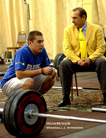 Norik Vardanian (left) conferring with his father, Yurik Vardanian (right), in the training hall (a tent, actually, replete with Oriental rugs) at the 2004 World Weightlifting Championships (Doha, Qatar). IronMind® | Randall J. Strossen photo.