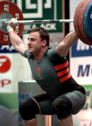 Ruslan Novikau (Belarus) looked like he had this 172.5-kg snatch, but he lost it as he was recovering. IronMind® | Randall J. Strossen, Ph.D. photo.