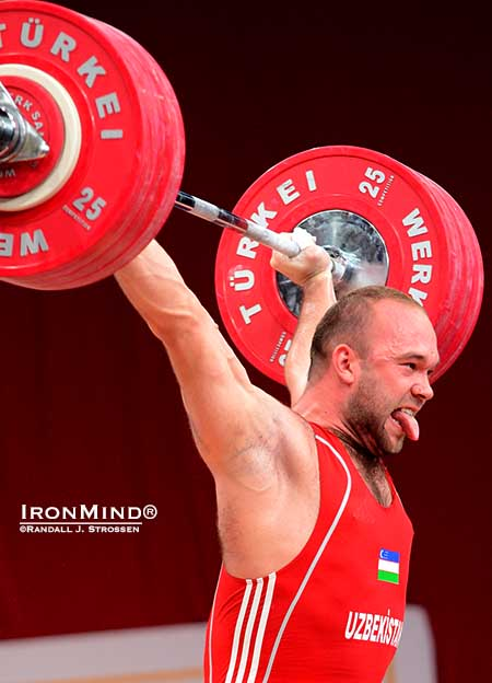 It's his trademark: Ruslan Nurudinov celebrates his successful 190-kg gold medal snatch by sticking out his tongue.  IronMind® | Randall J. Strossen photo