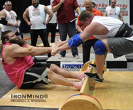 "Robert ""OB"" Oberst (left) launches James Rude at the Mas wrestling event which was part of the 2013 Odd Haugen Strength Classic at the Los Angeles FitExpo.  IronMind® 