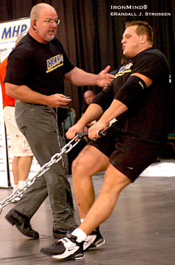 Whether its running global fitness industry businesses, organizing top strongman competitions, giving guys half his age a run for their money, or getting into the trenches as a referee, Odd Haugen has quite a resume in strongman. Here, Odd encourages Travis Ortmayer at the 2004 NAS Nationals, where Ortmayer won the title. IronMind® | Randall J. Strossen photo.