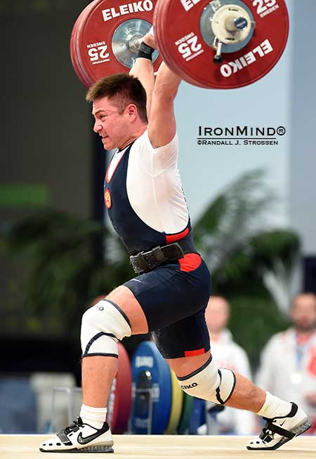 Oleg Chen (Russia)  jerked 176 kg to complete his gold medal sweep in the men's 69-kg class.  IronMind® | Randall J. Strossen photo