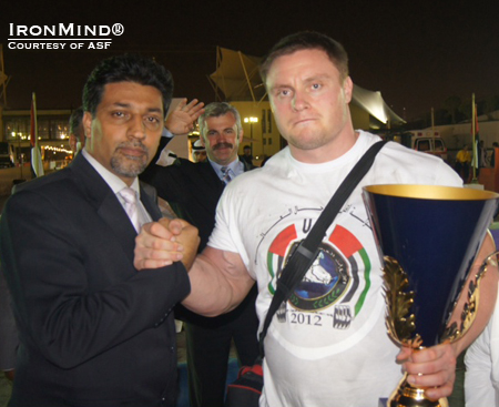 ASF president Omid Amiri (left) congratulates WSF World Strongmen Championships winner, Krzysztof Radzikowski.  That's WSF president Vlad Redkin waving in the background.  IronMind® | Courtesy of ASF.