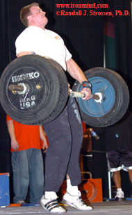 Dave Ostlund works some two-meter magic on an IronMind® Apollon's Axle™ fitted with tires at the 2005 FitExpo. Ostlund went on to qualify for the 2005 World's Strongest Man contest, where he made the finals and placed ninth overall. IronMind® | Randall J. Strossen, Ph.D. photo.