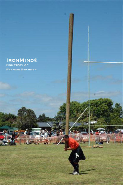 Pat Hellier on the caber.  IronMind® | Photo courtesy of Francis Brebner.