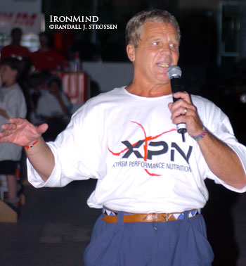 Paul Ohl introduces the back lift at the 2004 World Muscle Power Championships in Dolbeau-Mistassini (Quebec, Canada). Paul Ohl most likely is the world's leading expert on the great Louis Cyr and by virtue of this, he is also uncommonly familiar with the back lift. IronMind® | Randall J. Strossen, Ph.D. photo.