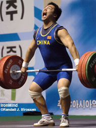 Peng Feng (China) is about to pop the 151-kg snatch that put him in the driver's seat at the Asian Junior Championships today in Gunsan, Korea. IronMind® | Randall J. Strossen, Ph.D. photo.