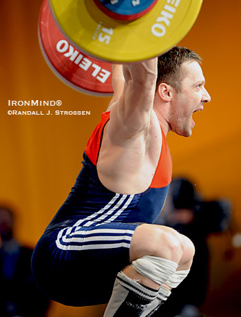 On this way back up with his 164-kg third attempt snatch, Oleg Perepechenkov (Russia) stayed focused and won the top honors in the 77-kg class at the European Weightlifting Championships. IronMind® | Randall J. Strossen photo.