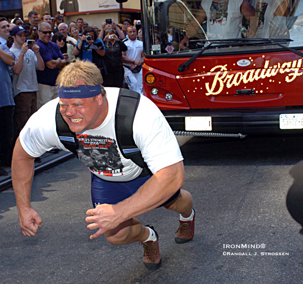 Phil Pfister thrills the crowd and gives the press an eyeful on 7th Avenue today, in front of Madison Square Garden, promoting the Super Series strongman contest set for Saturday night at The Garden. IronMind® | Randall J. Strossen photo.