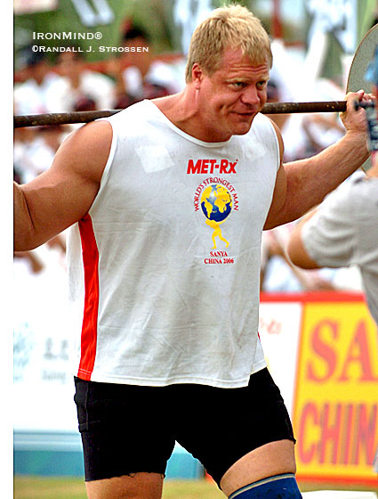 Taking a walk on the wild side, Phil Pfister warms up for the Car Walk at the 2006 World's Strongest Man. Destiny was calling and Pfister was reaching for the phone - a few hours later, he would be the first American since the mighty Bill Kazmaier to win the biggest competition in strongman, the World's Strongest Man contest. IronMind® | Randall J. Strossen photo.