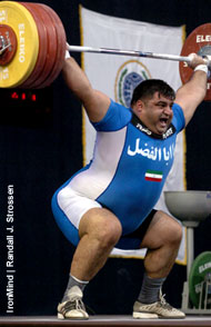 Hossein Rezazadeh (Iran) snatches 210 kg at the 2005 World Weightlifting Championships (Doha, Qatar), a rather routine weight for the two-time Olympic gold medalist. Evgeny Chigishev (Russia) snatched the gold, however, with a very impressive 211. Who will be the top super this year? IronMind® | Randall J. Strossen, Ph.D. photo.